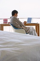 Man in robe with laptop