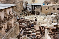 ´People working in tannery, elevated view´
