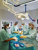 Team of nurses and surgeons in surgery