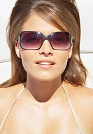Closeup of woman with sunglasses sunbathing