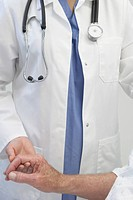 Close up of doctor holding senior patientÆs hand