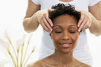 African woman receiving facial massage