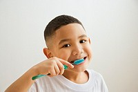 Portrait of Indian boy brushing teeth