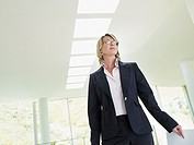 Businesswoman standing and smiling