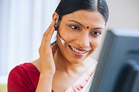 Indian woman using headset