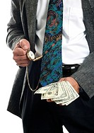 Businessman checking the time while holding cash in his hand