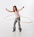 Greek girl playing with hula hoops
