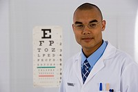 Male doctor in front of eye chart