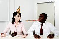 Businesswoman celebrating her birthday with a male colleague
