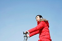 Woman listening to music while cycling