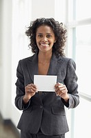 African businesswoman holding paper