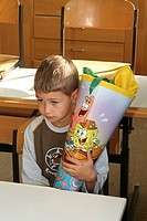 child with a paper funnel