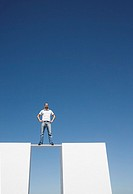 Man standing on board between two walls outdoors