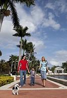 Hispanic family walking dog
