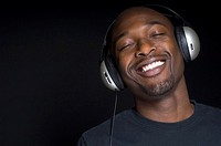 Portrait of African man wearing headphones