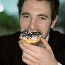 Guy eating doughnut