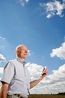 Senior man holding a mobile phone