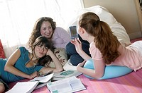 Teenage girls doing homework together
