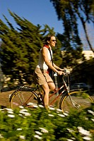 Blurred view of woman riding bike on college campus