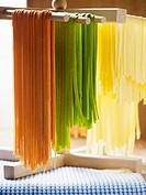 Coloured pasta hanging up to dry (thumbnail)