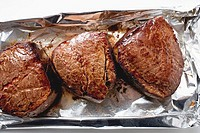 Three fillet steaks on aluminium foil