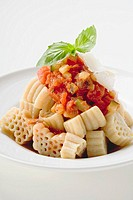 Pasta with tomato & vegetable sauce & Parmesan shavings