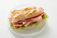 Sub sandwich with raw ham on a plate (thumbnail)