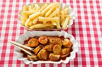 Currywurst sausage with ketchup & curry powder with chips (thumbnail)
