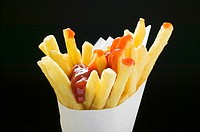 Chips with ketchup in paper cone