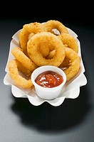 Deep-fried onion rings with ketchup