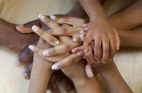 Family heaping hands on top of hands