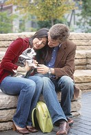 Couple petting small dog