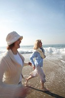 Mature women jogging on the beach