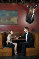 Couple in restaurant booth