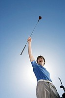 Man celebrating good golf swing