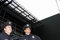 Male police officers standing outside Police Department