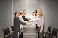 Businesspeople shaking hands in a meeting