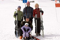 Family of skiers smiling