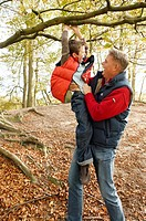 Father and son playing on tree