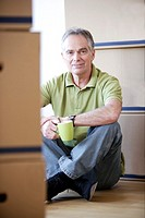 Man relaxing with coffee cup