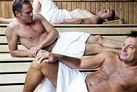Men relaxing in sauna