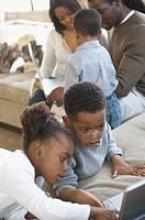 Children watching DVD player