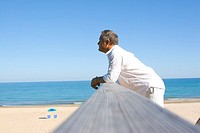 Middle-aged man looking over beach