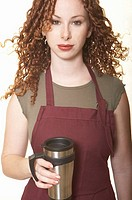 Young woman holding coffee mug