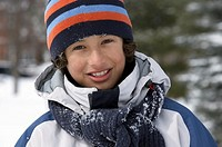 Young boy smiling in snow