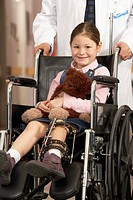 Girl wearing leg brace in wheelchair