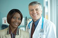 Smiling healthcare worker and doctor