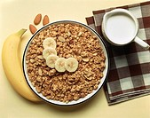 Muesli with almonds and sliced banana