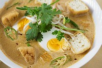 Laksa with boiled egg and okra pods Singapore