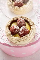 Meringue shell with raspberries, vanilla cream & icing sugar